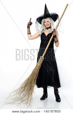 smiling witch with broom