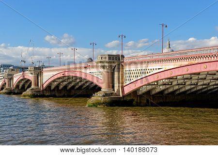 Blackfriars bridge - a road and foot traffic bridge over the river Thames in London UK.