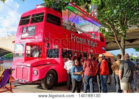 LONDON UK - JULY 1 2014: Frozen yogurt sold from the iconic double-decker red bus The Festival of Love at the Southbank Centre From 28 June 2014 to 31 August 2014.