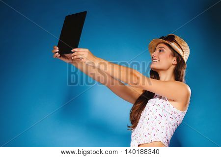 Technology internet modern lifestyle concept. Summer girl using digital tablet taking picture of herself. Selfie style. Woman with e-book reader touchpad pc.