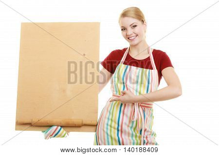 housewife in kitchen apron or small business owner with empty blank banner sign for restaurant menu recipe. Girl holding wooden board with copy space for text. Isolated on white