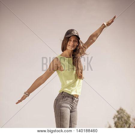 Portrait Of Carefree Teenager Girl Outdoor.