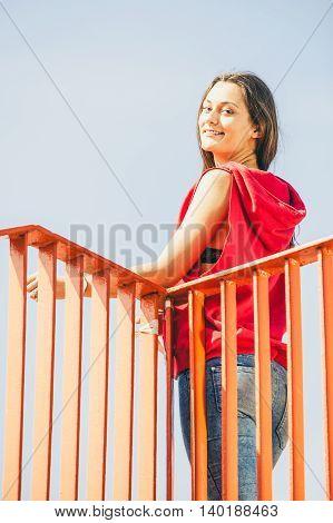 Urban Girl On Bridge In City.