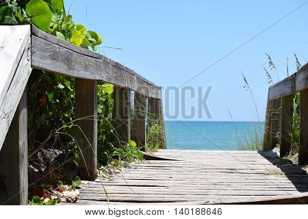 Beach Boardwalk Pathway to the Beach with View of Blue Ocean