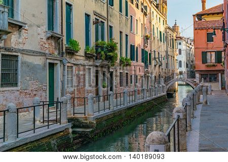 Morning along a charming canal in Venice Italy
