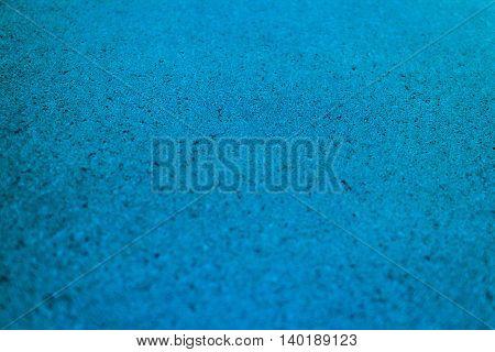 Selective focus blue textured background. Horizontal 3:2 format.