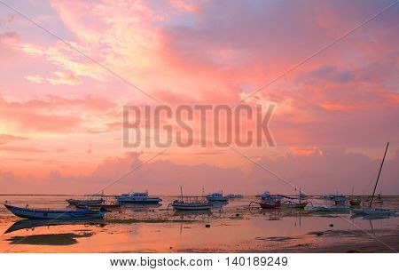 Dawn on the ocean. Pink morning in Bali