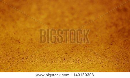 Selective focus gold textured background. Horizontal 16:9 format.