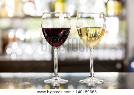 white and red wine in a table bar