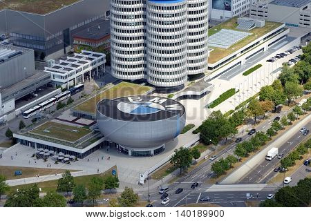 MUNICH GERMANY - AUGUST 4 2015: Aerial view of Munich with the BMW Museum and headquarters from the 291 m high Olympic tower (Olympiaturm).