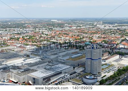 MUNICH GERMANY - AUGUST 4 2015: MUNICH GERMANY - AUGUST 4 2015: Aerial view of Munich with the BMW Museum and headquarters from the 291 m high Olympic tower (Olympiaturm).