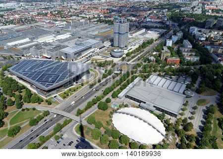 MUNICH GERMANY - AUGUST 4 2015: Aerial view of Munich with part of the Olympic Park the BMW Museum and headquarters from the 291 m high Olympic tower (Olympiaturm).