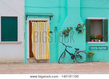 Bicycle in front of house in Burano Italy