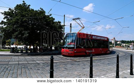 PRAGUE, CZECH REPUBLIC - JUNE 25, 2016: Red modern tram on street in Prague