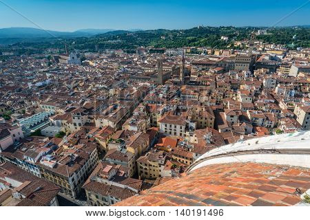 City of Florence viewed from the dome of the cathedral of Santa Maria with Basilica of Santa Croce in the distance.