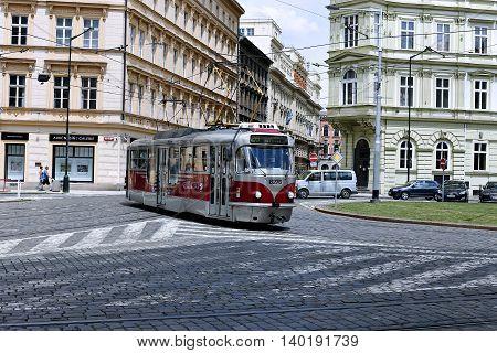 PRAGUE, CZECH REPUBLIC - JUNE 19, 2016: Red tram on street in Prague