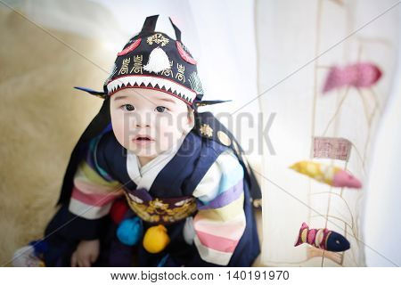 Adorable one year old Korean Boy wearing Traditonal Costume