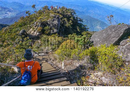 Mount Kinabalu,Ranau,Sabah,Borneo-March 13.2016:Undentified of climber enjoying the amazing view of the Ranau and Kundasang town from viewpoint Mount Kinabalu.