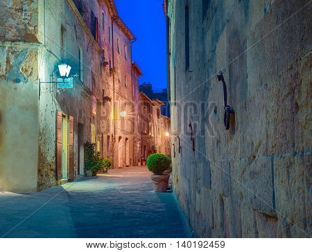 Street in the Tuscan village of Pienza Italy at night.
