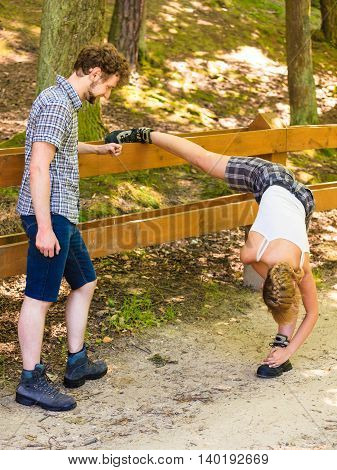 Hiker Young Couple In Nature Preparing To Hike