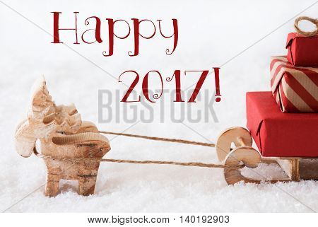 Moose Is Drawing A Sled With Red Gifts Or Presents In Snow. Christmas Card For Seasons Greetings. English Text Happy 2017 For Happy New Year Greetings