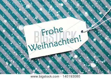 One Label On A Turquoise Striped Wrapping Paper. Textured Background With Snowflakes. Tag With Ribbon. German Text Frohe Weihnachten Means Merry Christmas