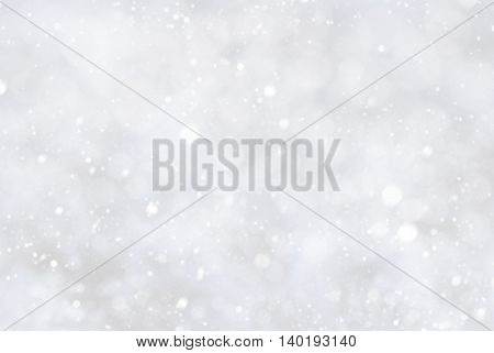 Christmas Texture With Snowflakes. White Background. Card For Seasons Greetings. Magic Bokeh Effect With Lights. Copy Space For Advertisement.