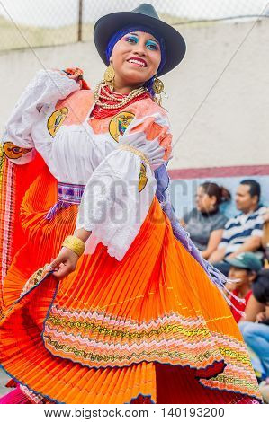 Banos De Agua Santa Ecuador - November 29 2014: Unidentified Youth Indigenous Woman Dancing On City Streets Of Banos De Agua Santa South America