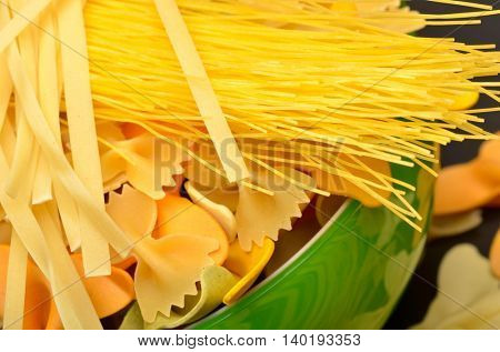 various uncooked pasta as background