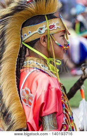 Coeur d'Alene Idaho USA - 07-23-2016. Side profile of Native American boy. Young dancer participates in the Julyamsh Powwow on July 23 2016 at the Kootenai County Fairgrounds in Coeur d'Alene Idaho.