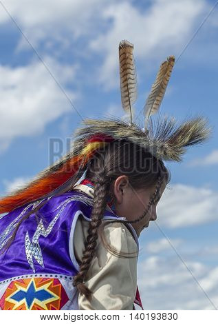 Coeur d'Alene Idaho USA - 07-23-2016. Feathers on the boy's head. Young dancer participates in the Julyamsh Powwow on July 23 2016 at the Kootenai County Fairgrounds in Coeur d'Alene Idaho.