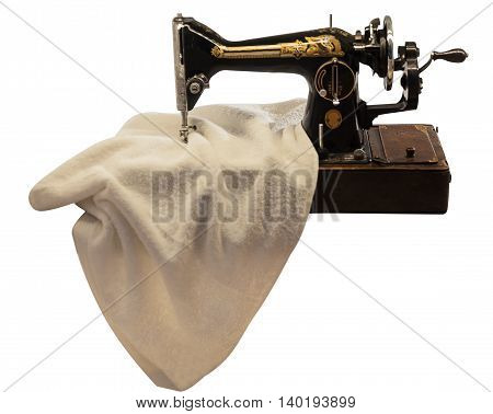 sewing machine with fabric isolated on the white background