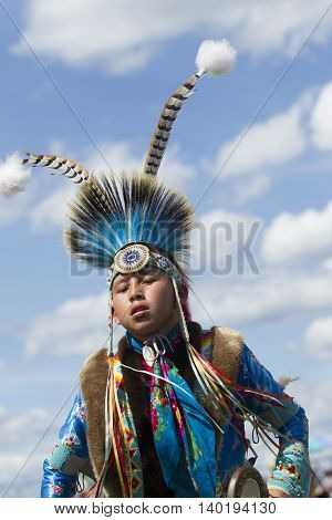 Coeur d'Alene Idaho USA - 07-23-2016. Native American youth at Powwow. Young dancer participates in the Julyamsh Powwow on July 23 2016 at the Kootenai County Fairgrounds in Coeur d'Alene Idaho.