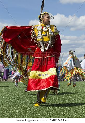 Coeur d'Alene Idaho USA - 07-23-2016. Young woman at Native American Powwow. Young dancer participates in the Julyamsh Powwow on July 23 2016 at the Kootenai County Fairgrounds in Coeur d'Alene Idaho.