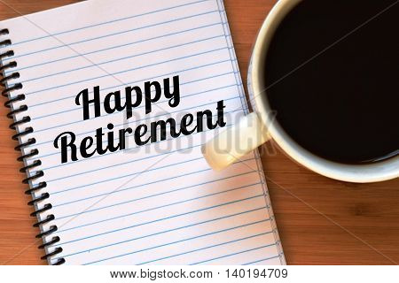 retirement concept, happy retirement written on a notebook