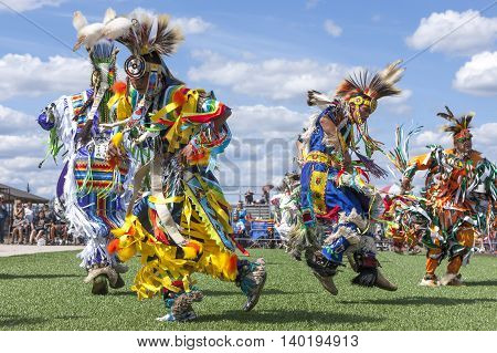 Coeur d'Alene Idaho USA - 07-23-2016. Stepping out at the powwow. Young dancers participate in the Julyamsh Powwow on July 23 2016 at the Kootenai County Fairgrounds in Coeur d'Alene Idaho.