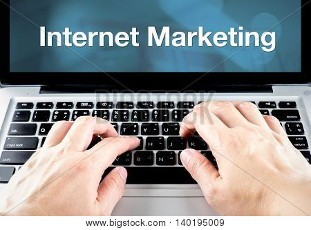 Hand Type On Laptop With Internet Marketing On Screen With Blur Blue Background, Online Business Con