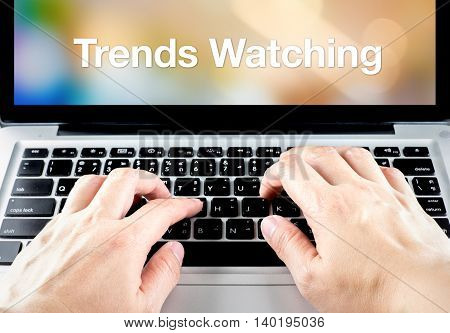 Hand Type On Laptop With Trends Watching On Screen With Blur Background, Online Business Concept