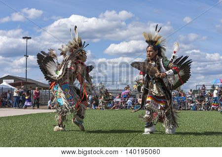 Coeur d'Alene Idaho USA - 07-23-2016. Opposing Native Americans at powwow dance. Young dancers participate in the Julyamsh Powwow on July 23 2016 at the Kootenai County Fairgrounds in Coeur d'Alene Idaho.