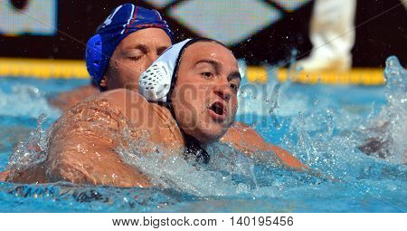 Budapest Hungary - Jul 14 2014. Alexandre CAMARASA (FRA 12) and Sava RANDJELOVIC (SRB 4) wrestling in the pool. Waterpolo European Championship was held in Alfred Hajos Swimming Centre in 2014.