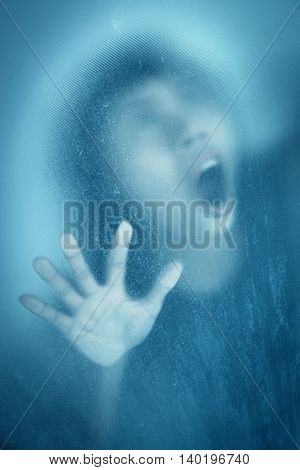 Woman screaming behind stained or dirty window glass,Scary background for book cover