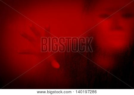 Woman wearing white mask behind stained or dirty window glass,Scary background for book cover