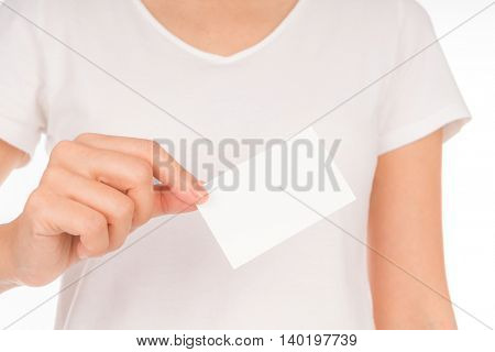 Women hand holding blank paper business card isolated on white background