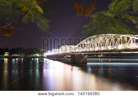 Trang Tien Bridge at night, Hue, Vietnam. This is the most beautiful bridge in Hue, connecting north and south of Perfume River.