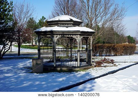 JOLIET, ILLINOIS / UNITED STATES - NOVEMBER 24, 2015: A gazebo in Joliet, after a November snow storm.