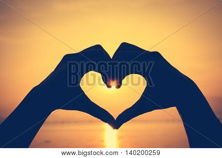 Valentine Background. Love Shape Hand Silhouette On Sky Background.