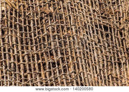 A background texture of burlap cloth rough jute mesh
