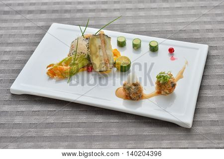 Meat ball with vegetables lime cucucmber on white plate in asian restaurant