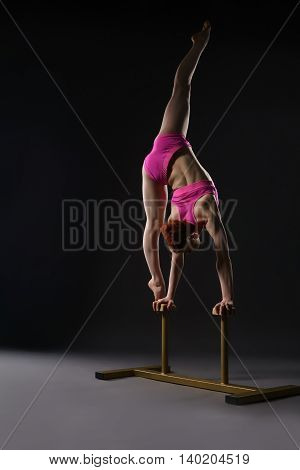Tightrope walker training. Photo on gray background