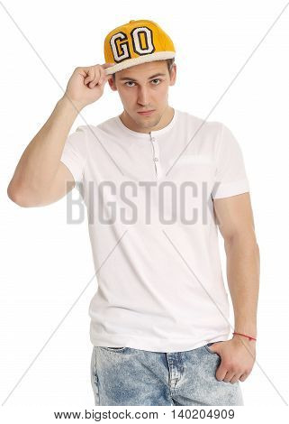 Handsome Young Man In Cap Posing Against White